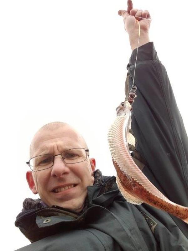 Stefan, vissen aan Wijk aan zee