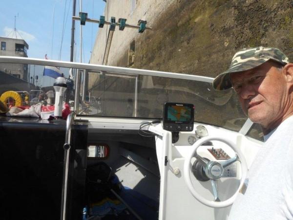 Samen met Romy, vissen met onze boot
