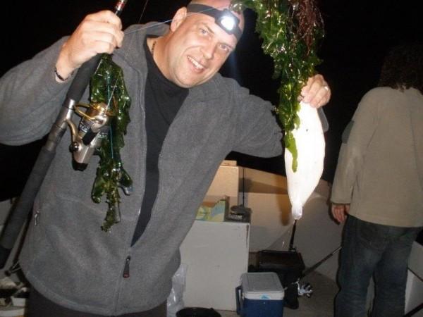 Vissen met een boot van Dixhoorn